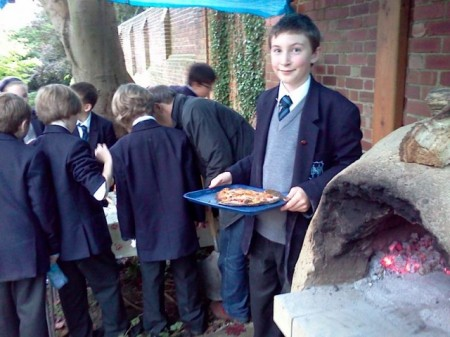 Northbridge Dig-It Club makes pizza in Fitzjohn's cob oven.